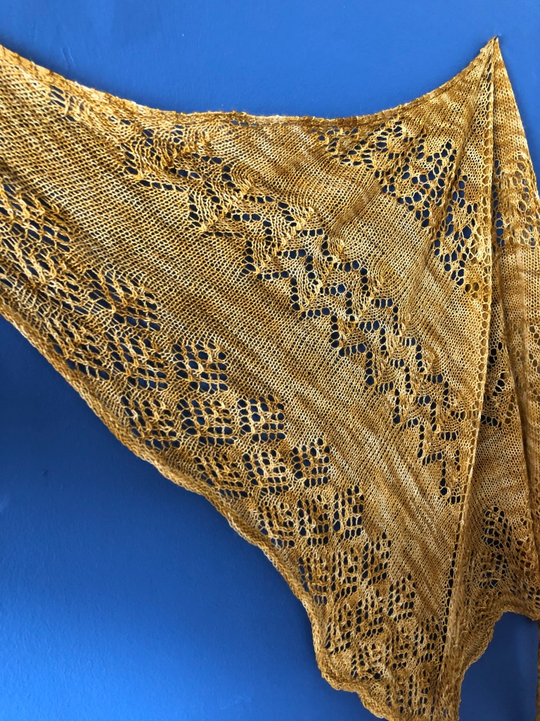 Beatrice shawl opened up on one side to show lace detailing