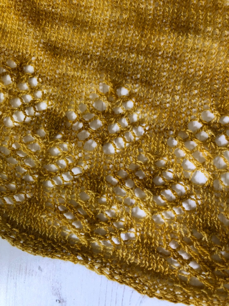 Detail of mustard yellow lace shawl edging