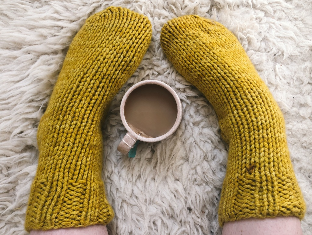 Chunky knit bedsocks with a cup of tea